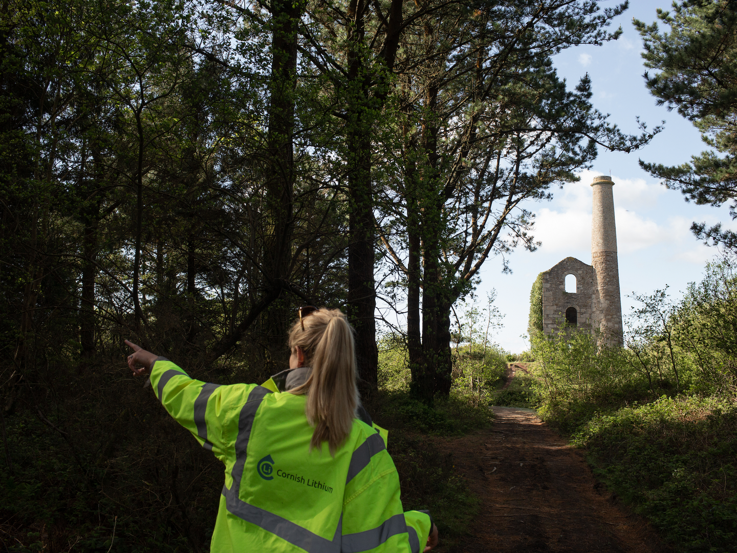 Cornish Lithium lead geologist Lucy Crane walks through a forest towards an old processing plant at ...