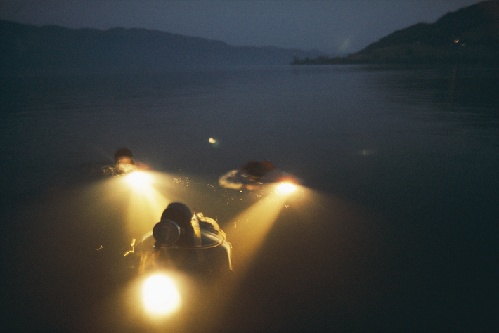 National Geographic photographers and scientists dive in Loch Ness as part of a 1977 story to ...
