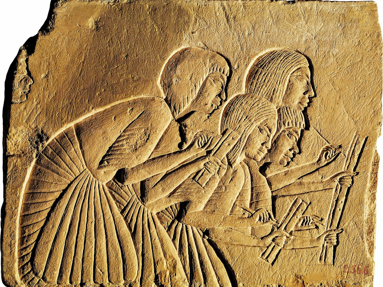 Scribes jot down the words of the powerful in a relief from the Tomb of Horemheb, ...