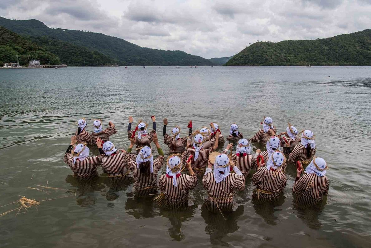 During the Ungami Festival, women wade into Shioya Bay to welcome the men of the village ...