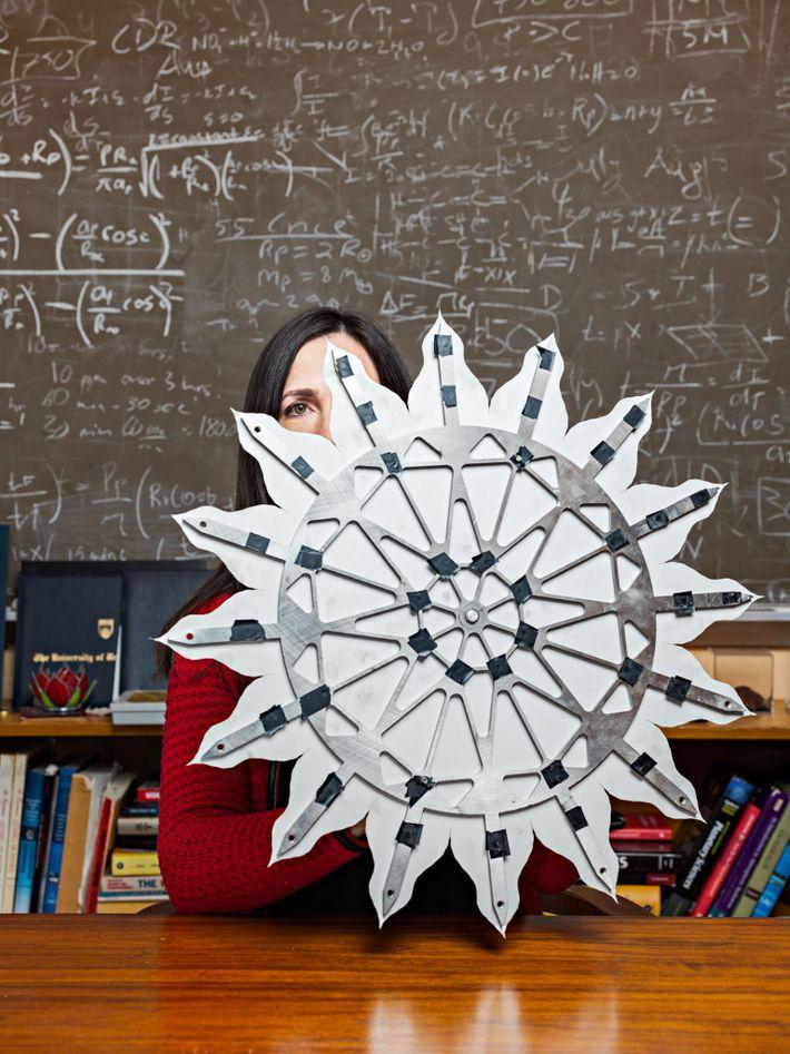 Using a model, MIT astrophysicist Sara Seager demonstrates Starshade, under development at NASA's Jet Propulsion Lab ...