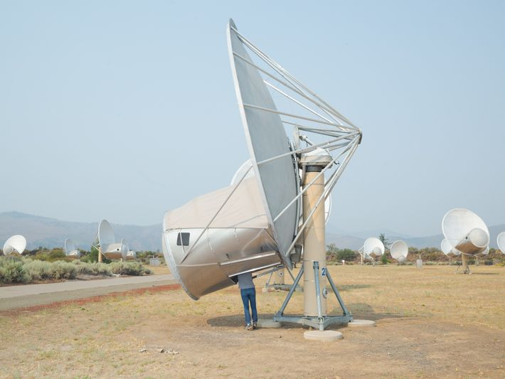 SETI Institute Senior Software Engineer Jon Richards works on one of the units in the Allen ...