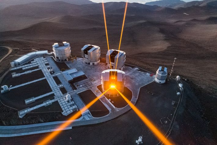 Laser beams streak from the European Southern Observatory's Very Large Telescope array in Chile's Atacama Desert. ...