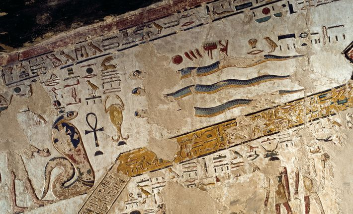 Serpents slither in a scene from a funerary text, the Book of Amduat, painted on the ...