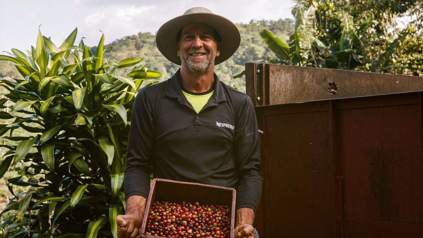 Luis Emilio with a plump, fresh batch of coffee cherries. Luis is immensely proud of the ...