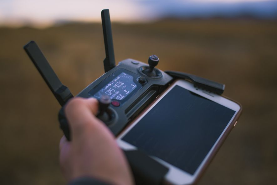 Most drones are controlled via smartphone interface, which allows the operator to 'see' what the drone ...