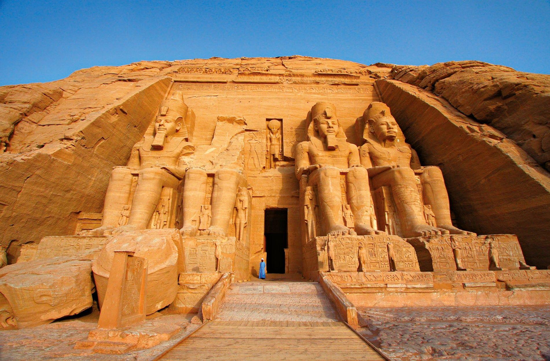 Colossal statues of Egyptian pharaoh Ramses II guard the entrance to Abu Simbel's main temple.