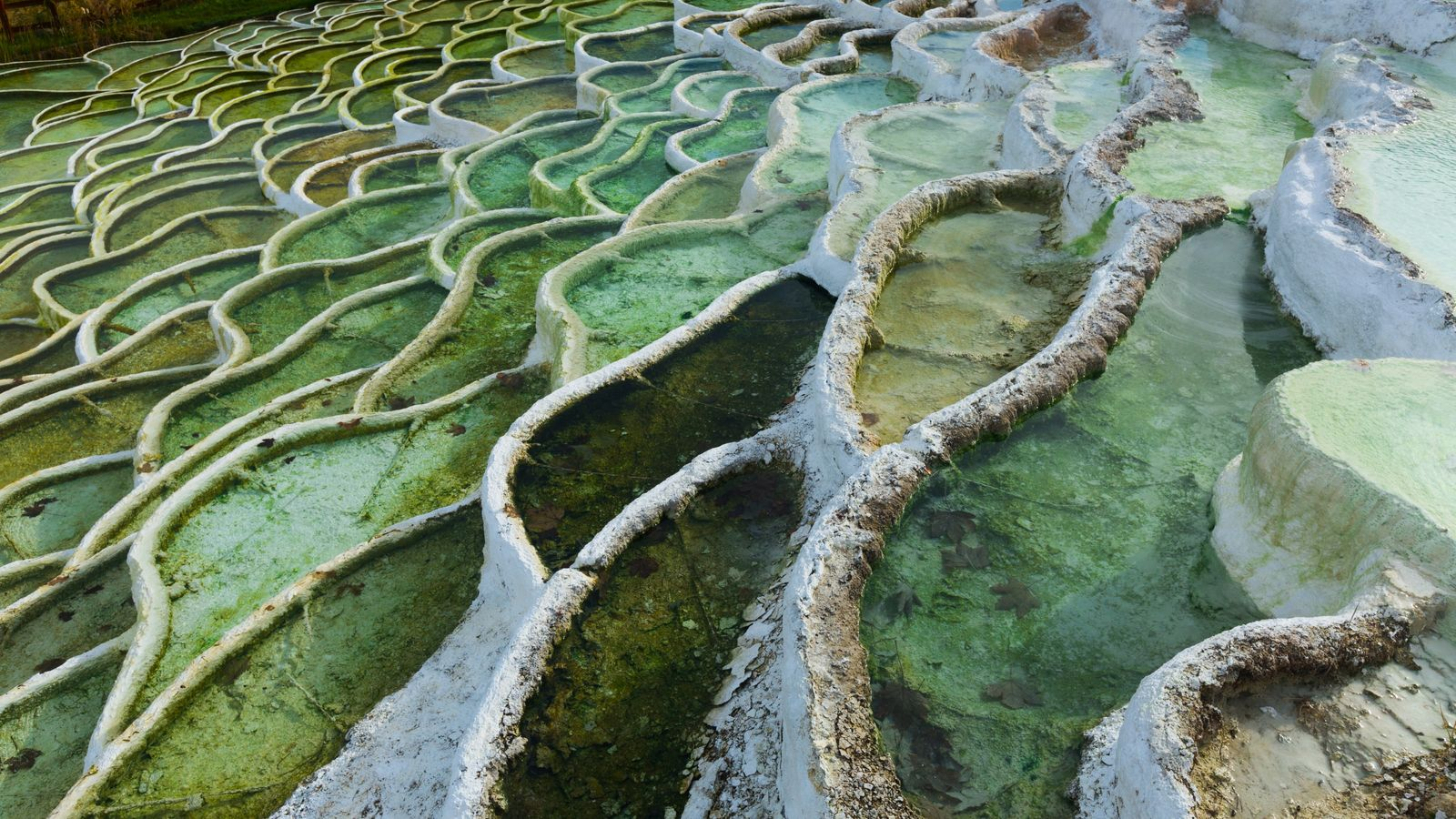 The colorful thermal waters in Egerszalok sit within terraced limestone formations lined with travertine.