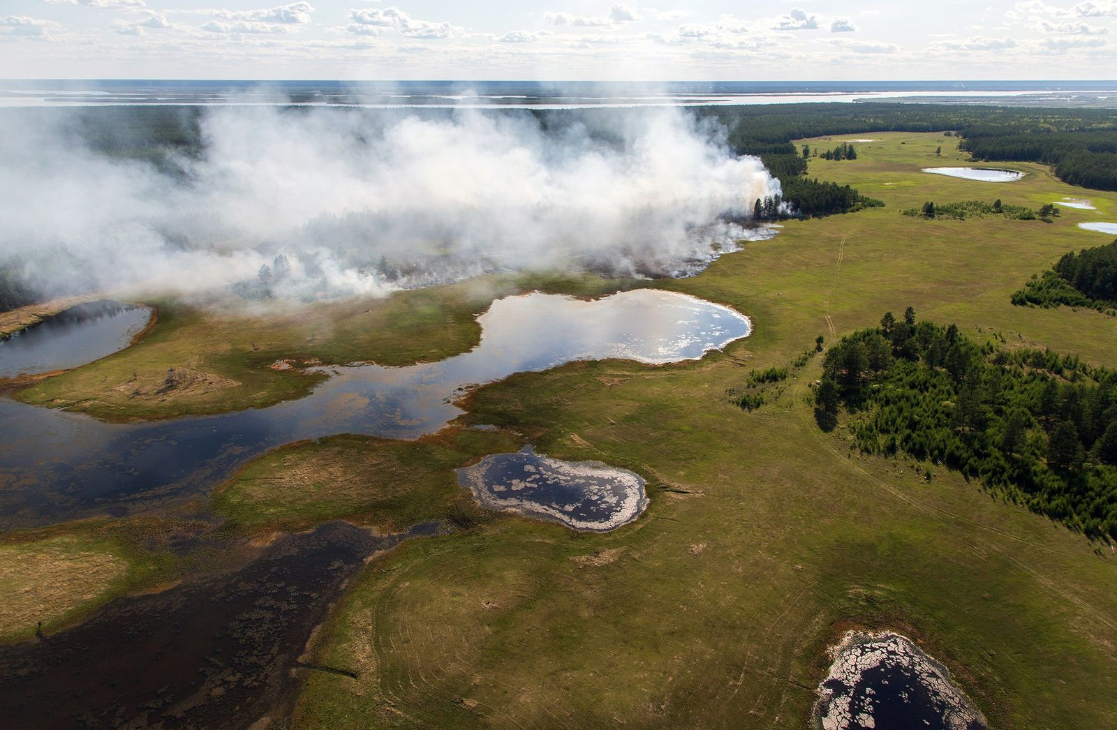 A heat wave thawed Siberia's tundra. Now, it's on fire.