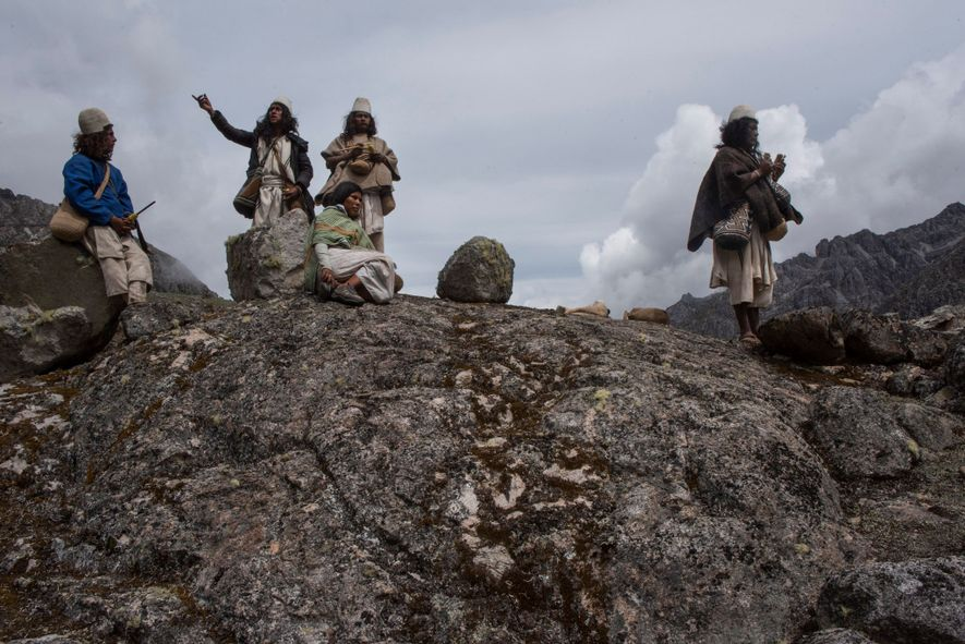 Under the guidance of Mamo Adolfo Chaparro (right), Arhuaco pilgrims carry out spiritual work. Here, he ...