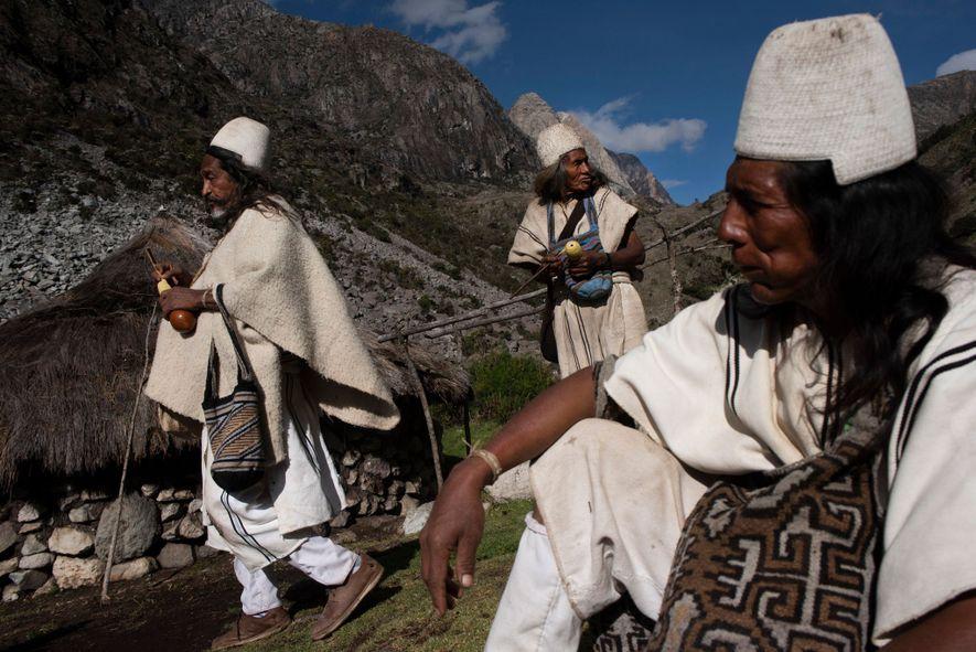 From left to right: Amado Villafaña, Diego Chaparro, and Eulogio Villafaña pause at a homestead several ...