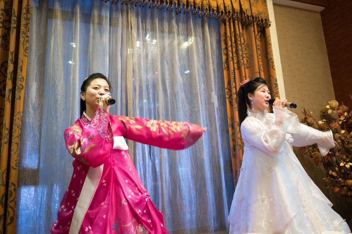 North Korean performers sing at a hotel in Dandong, China.