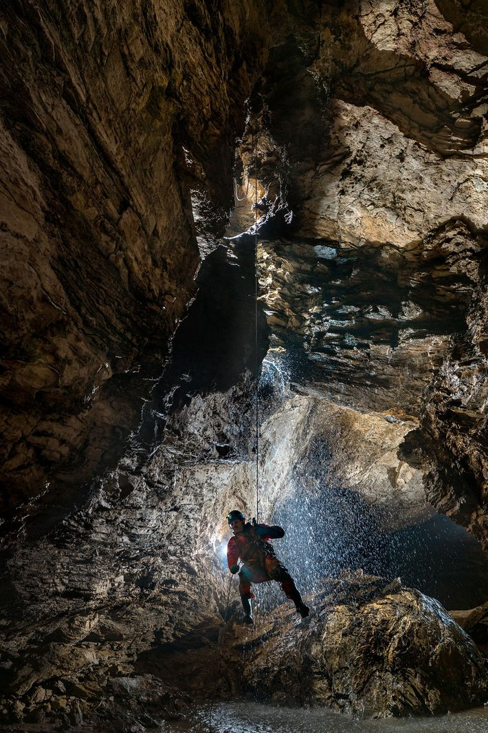 British caver Martin Hoff, one of several international members of the expedition team, rappels into an ...