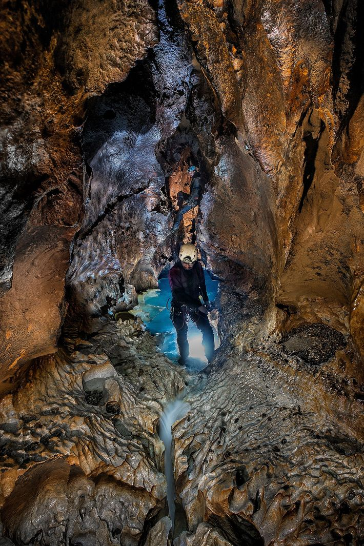 A member of the expedition travels through a portion of Sistema Huautla that sits behind one ...
