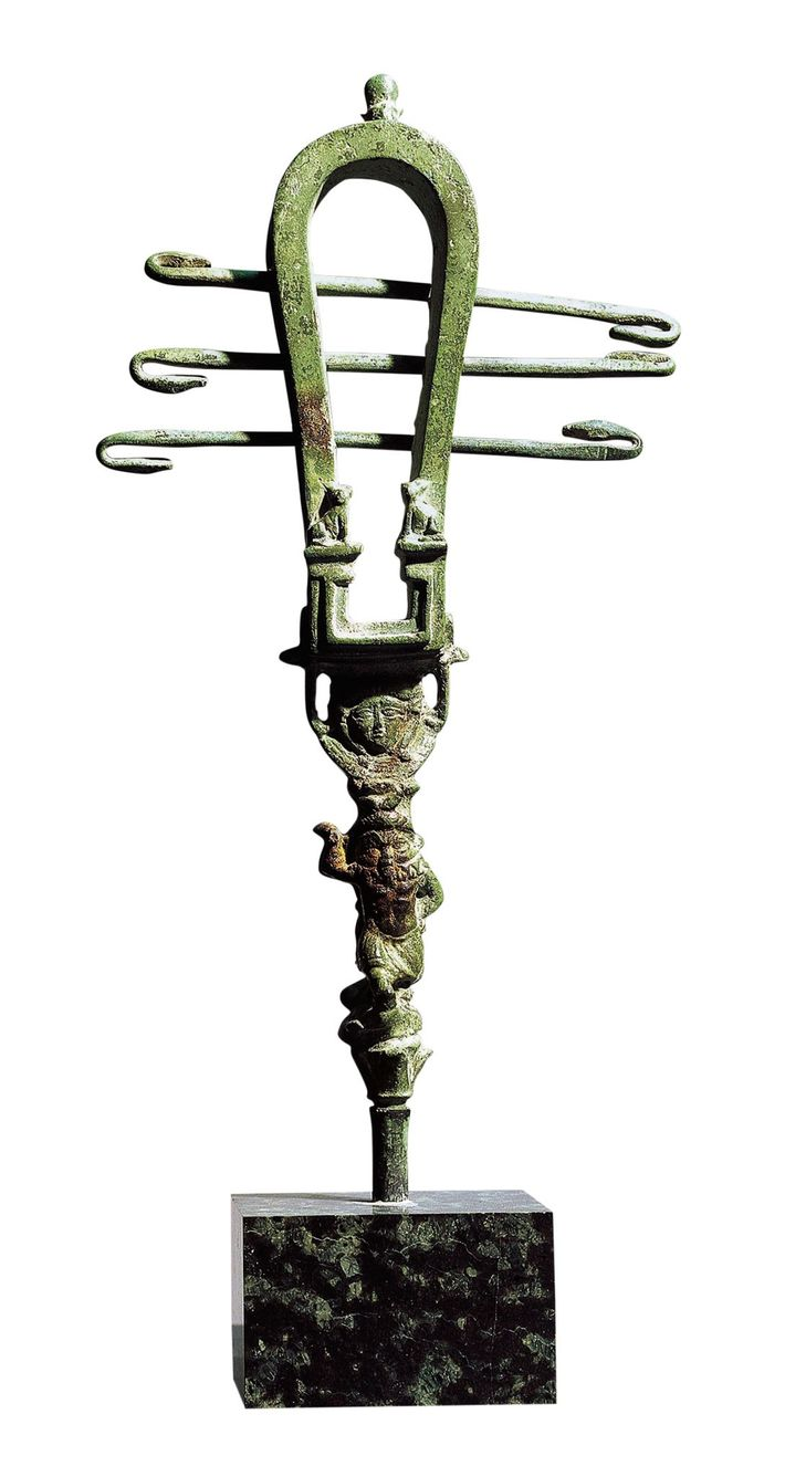 An undated bronze sistrum, a rattle used in the worship of Isis, was discovered near her ...