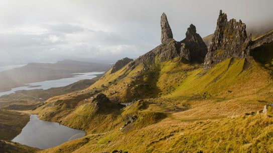 The Old Man of Storr against an ominous autumn sky. The dramatic rock formation is the ...
