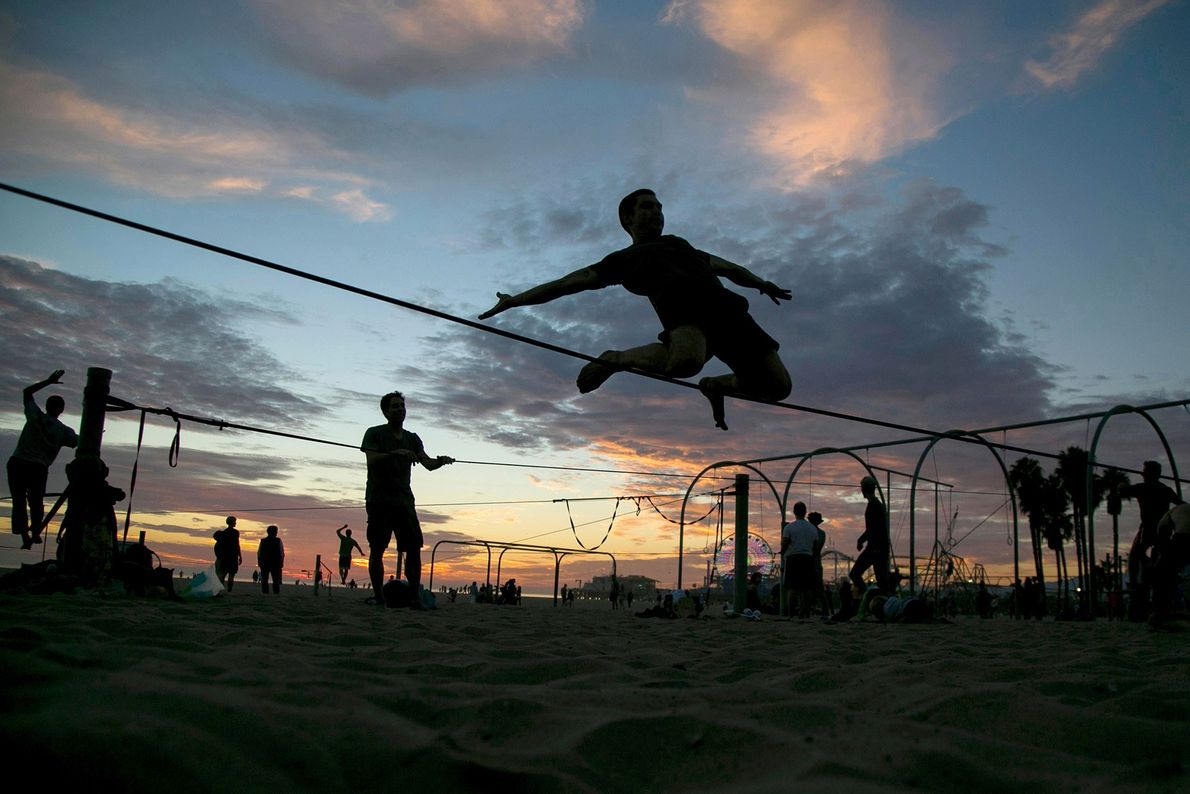 Slacklining is the newest addition to Santa Monica's Muscle Beach, giving enthusiasts a chance to practice ...