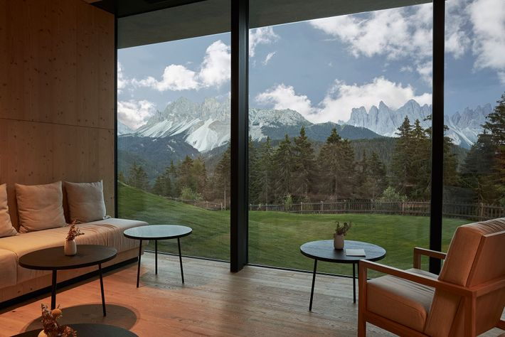 The spa lounge at Forestis overlooks the snowy peaks of the Dolomites.