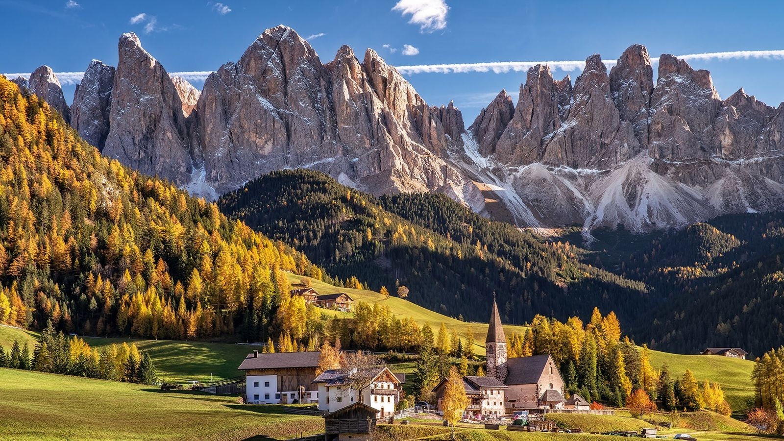 The Church of St. Magdalena in Funes Valley, Alto Adige is surrounded by spectacular Dolomite scenery.