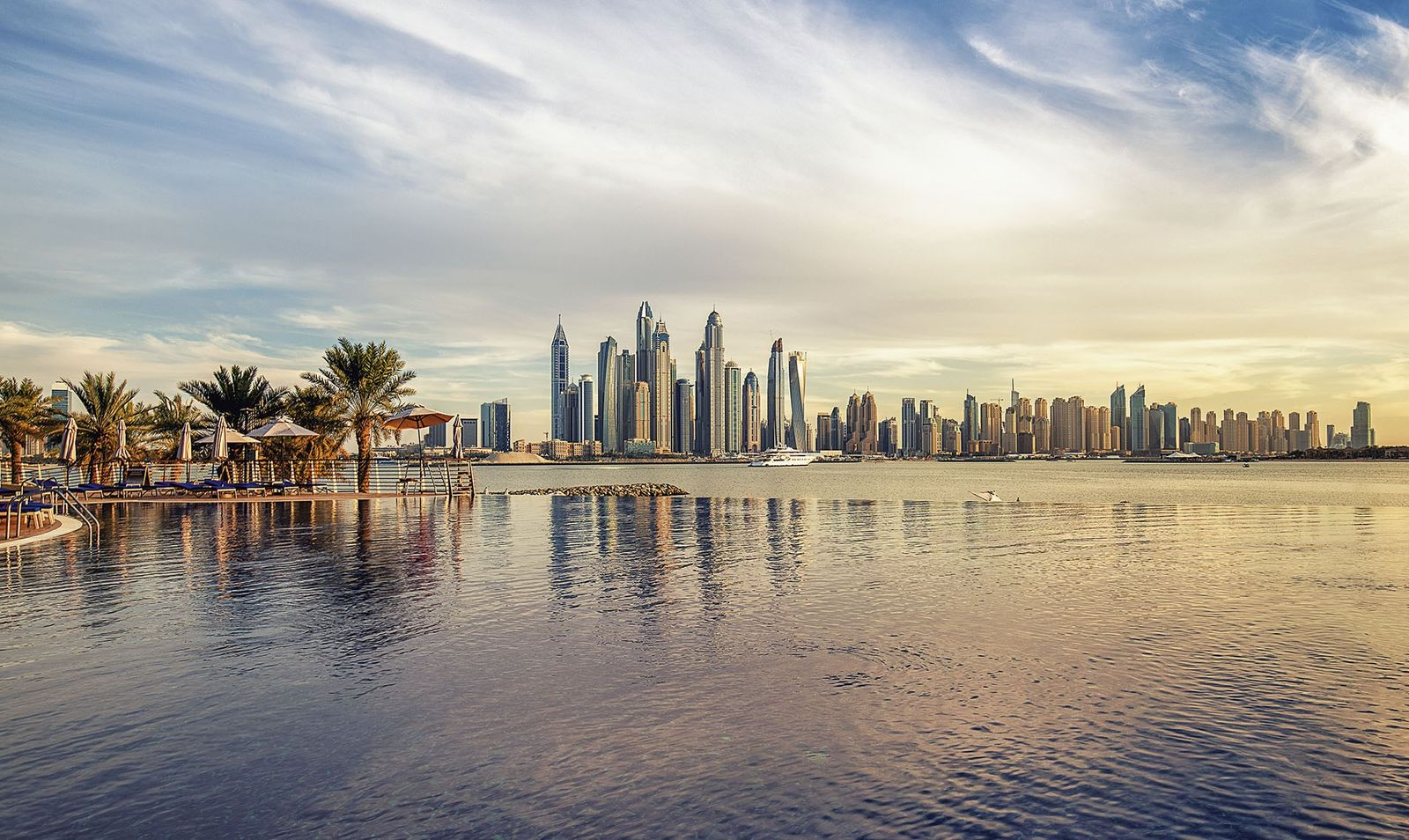 The Dubai skyline rising from the marina at the edge of the desert.