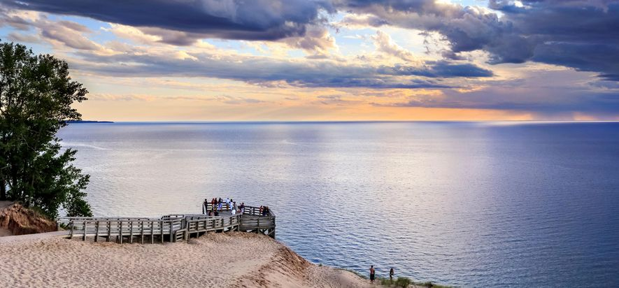 A wooden pier overlooks the vast blue waters at Lake Michigan Overlook in Sleeping Bear Dunes, ...