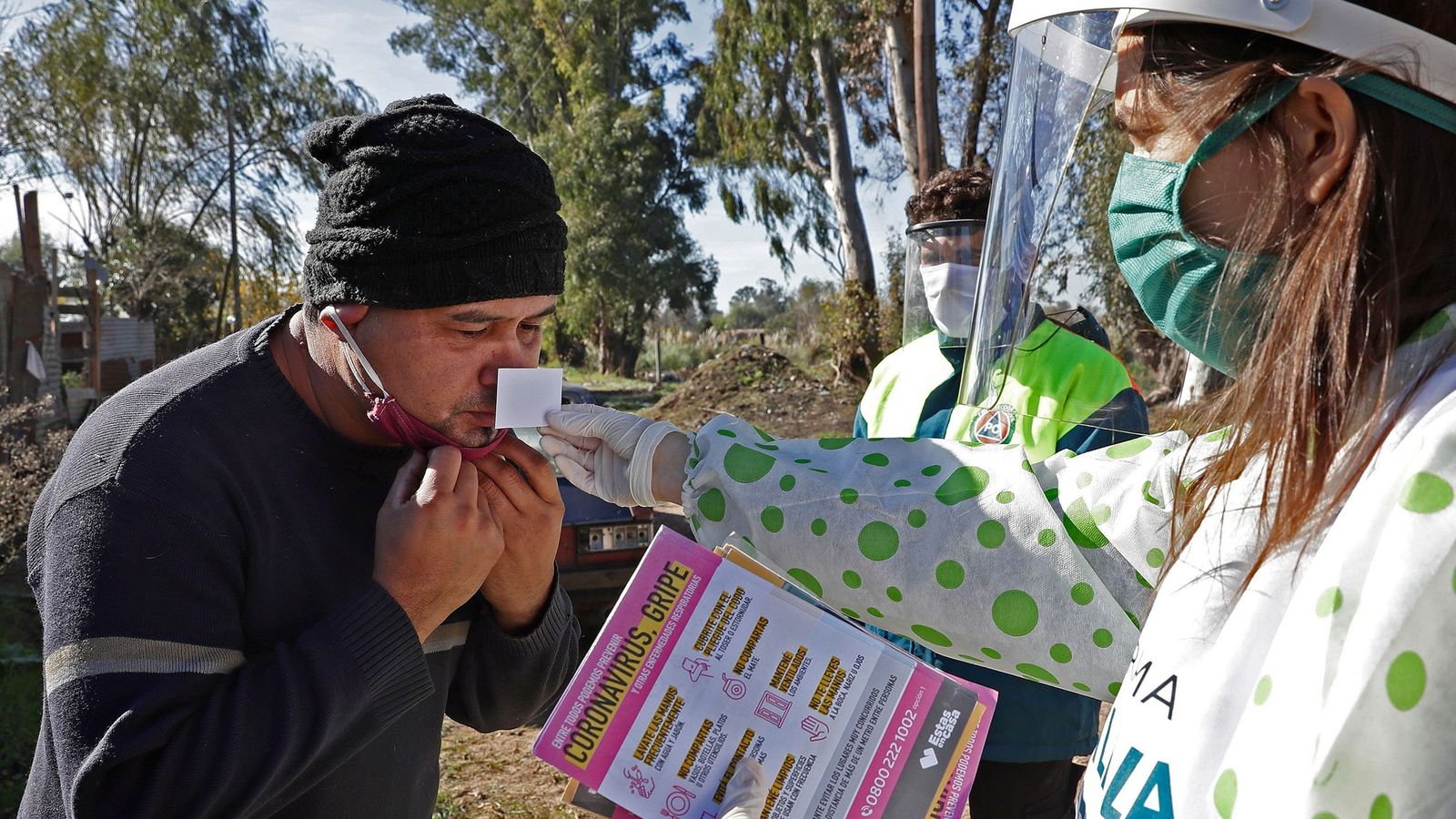 A health worker administers an olfactory test to monitor smell loss to a resident in the ...