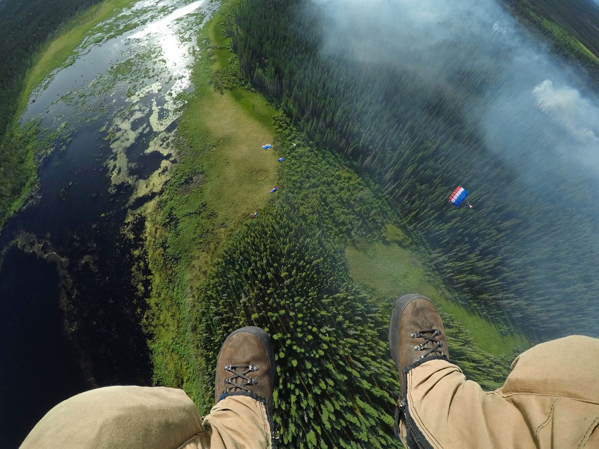 Matt Oakleaf, camera mounted on his gear bag, drops behind the rest of his team to ...