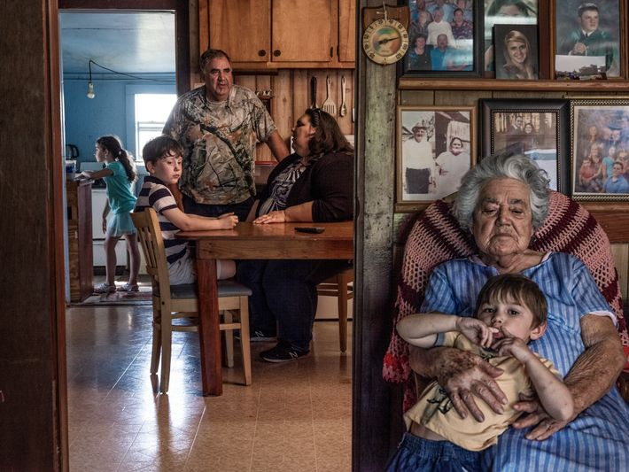 Chantel Comardelle and her family sit for a portrait in her grandparents' home on Isle de ...