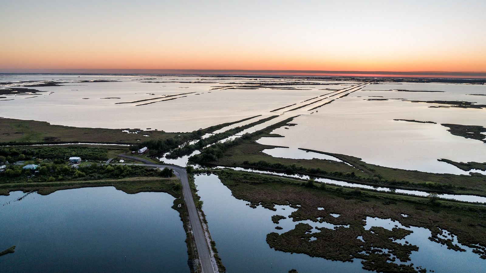 Tides and storms often flood the only road that connects Isle de Jean Charles to the ...
