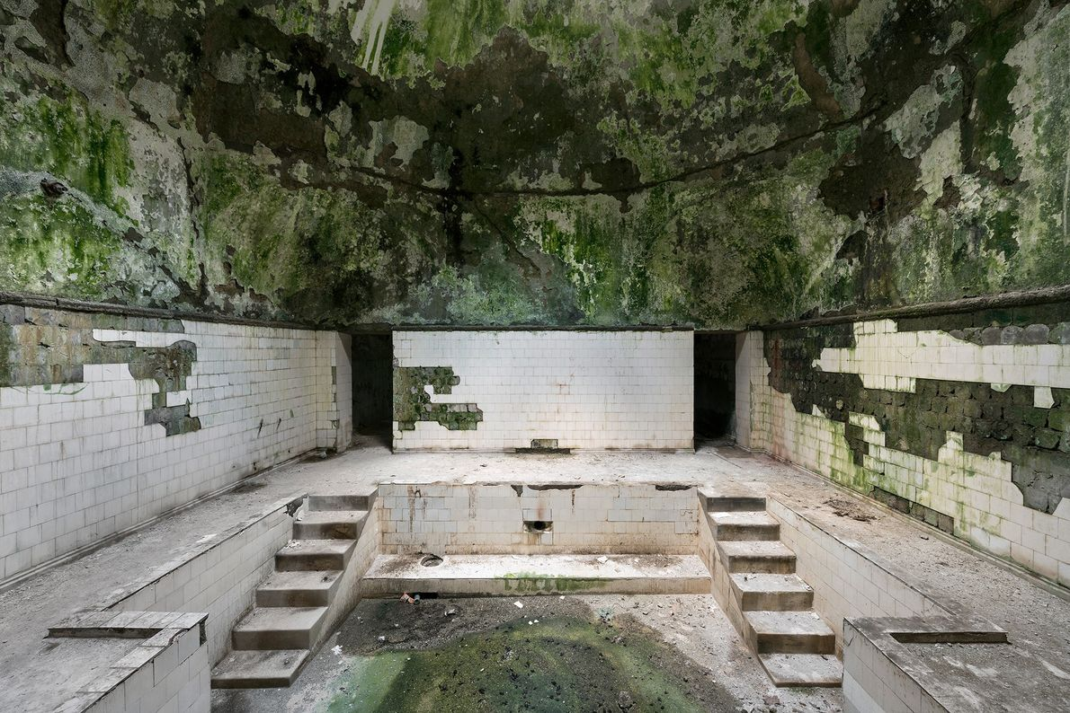 Water still flows through and underneath the baths in this derelict bathhouse, causing the buildings to …