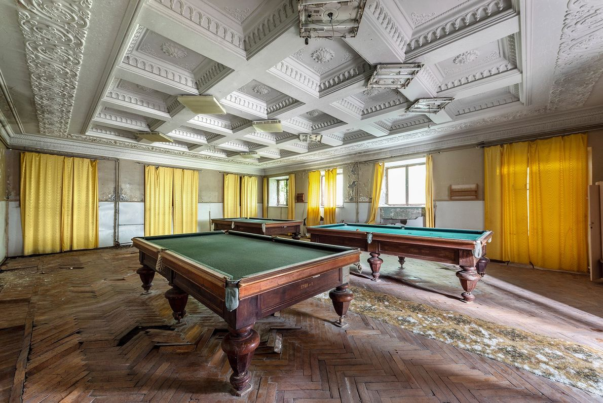 Billiard tables are left to rot inside this leisure room in Tskaltubo, Georgia.