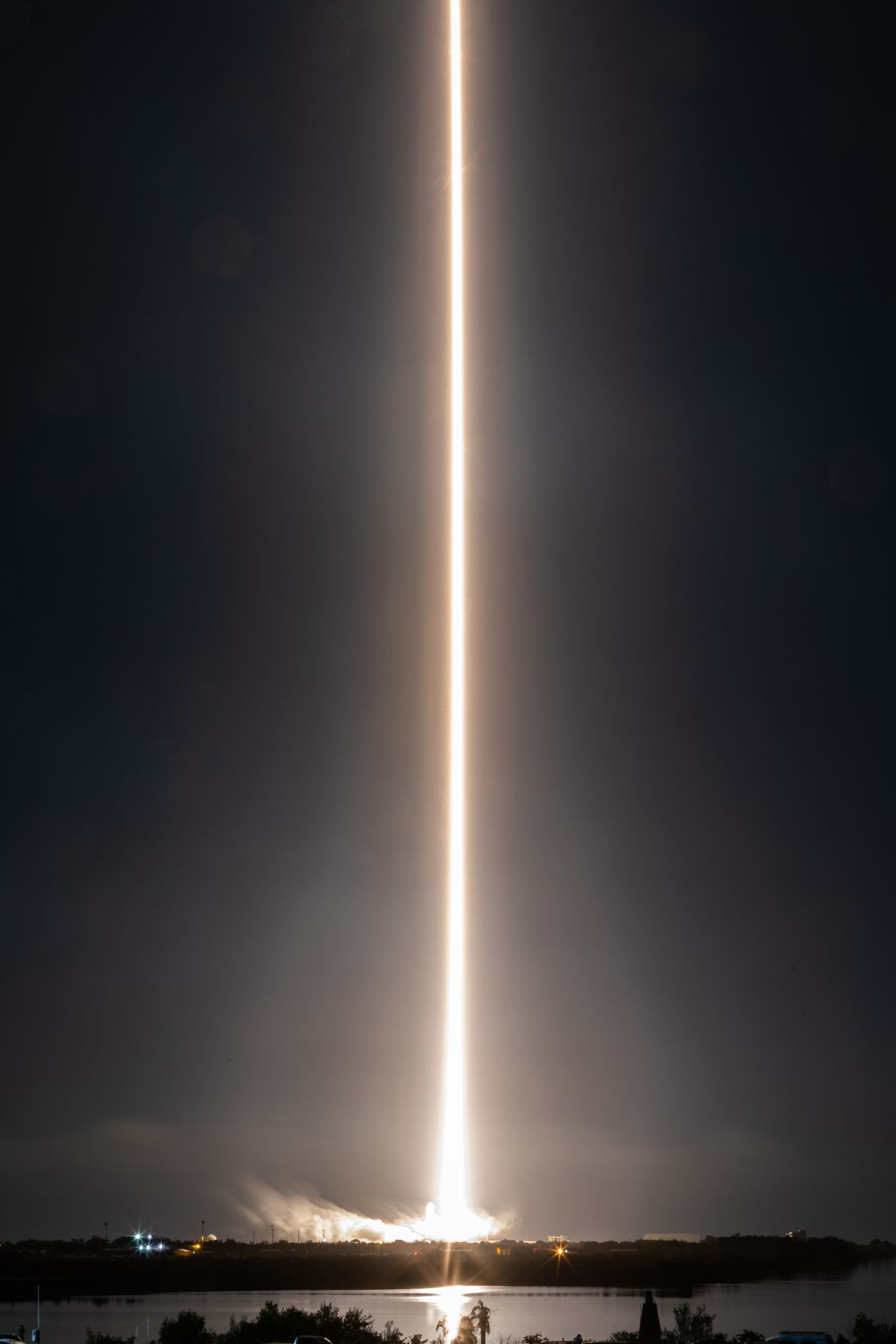 A long-exposure of the SpaceX's Crew Dragon craft lifting off into orbit from Kennedy Space Center ...