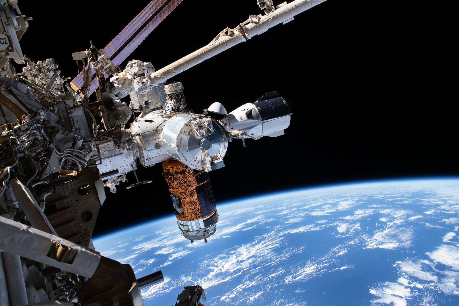 spacex crew dragon first trip spacecraft docking iss jpg?w=1600.'