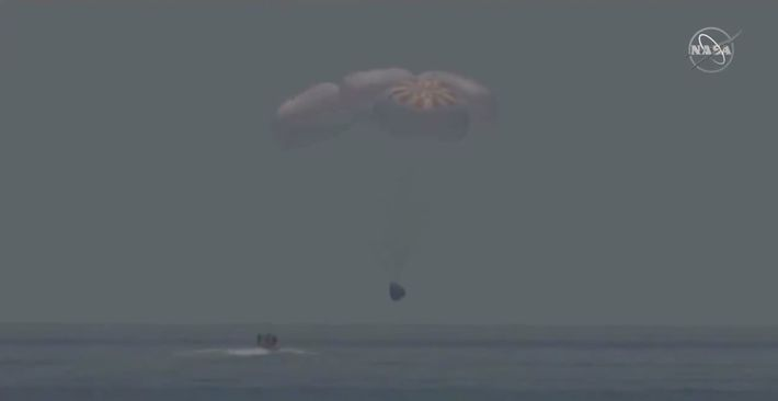 NASA astronauts Bob Behnken and Doug Hurley return to Earth in a SpaceX Dragon capsule after ...