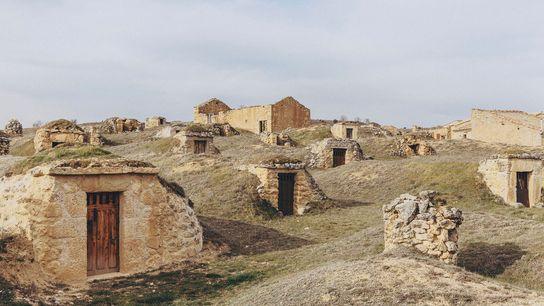 Historic bodegas clustered on a hillside near Atauta in the Ribera del Duero, north of Madrid.