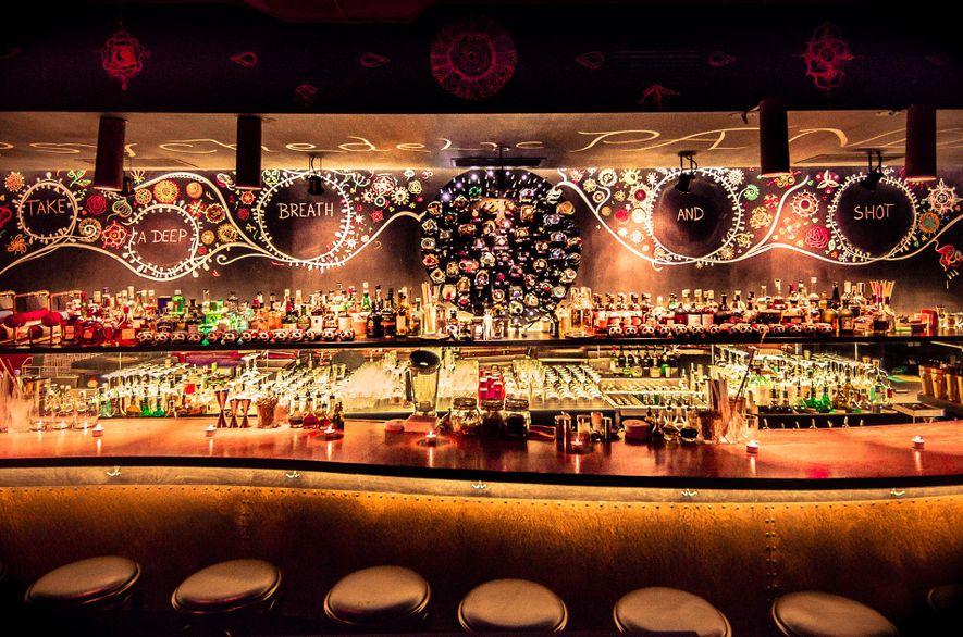 The low-lit bar of the cocktail bar Super Panda Circus, Brno.