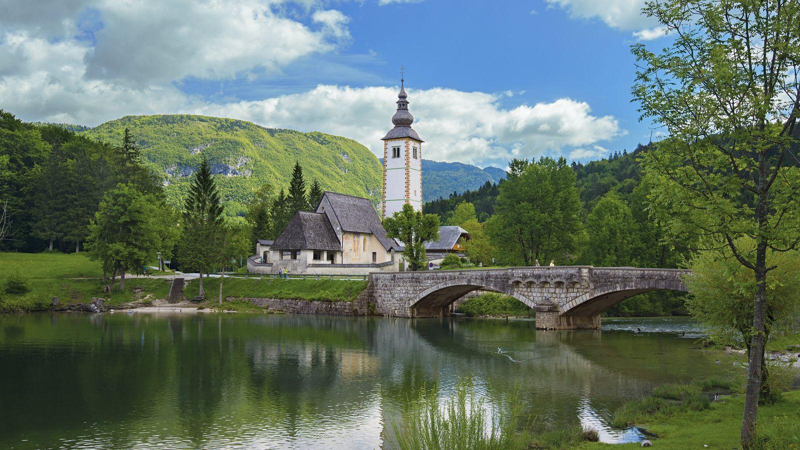 The church of St. John the Baptist sits behind Bohinj Lake in Slovenia.