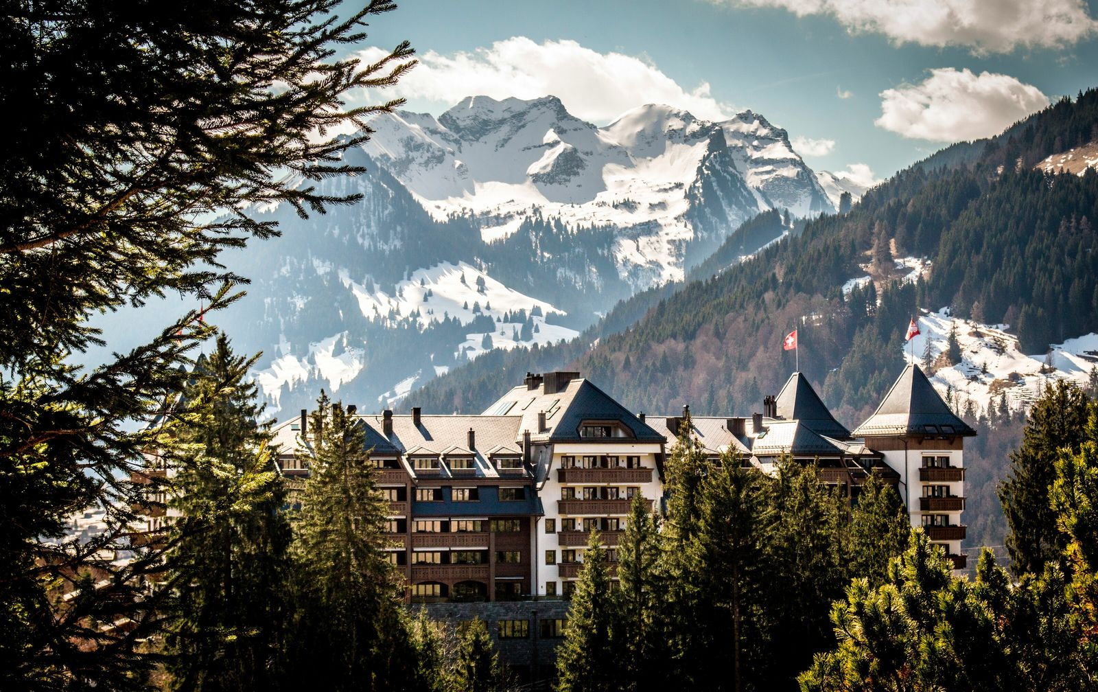 Gstaad is a timber-lined mountain town that's been twinned with Cannes for its glamorous restaurant scene.