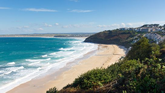 Carbis Bay is one of the county's seven award-winning Blue Flag beaches and enjoys gentle surf, ...