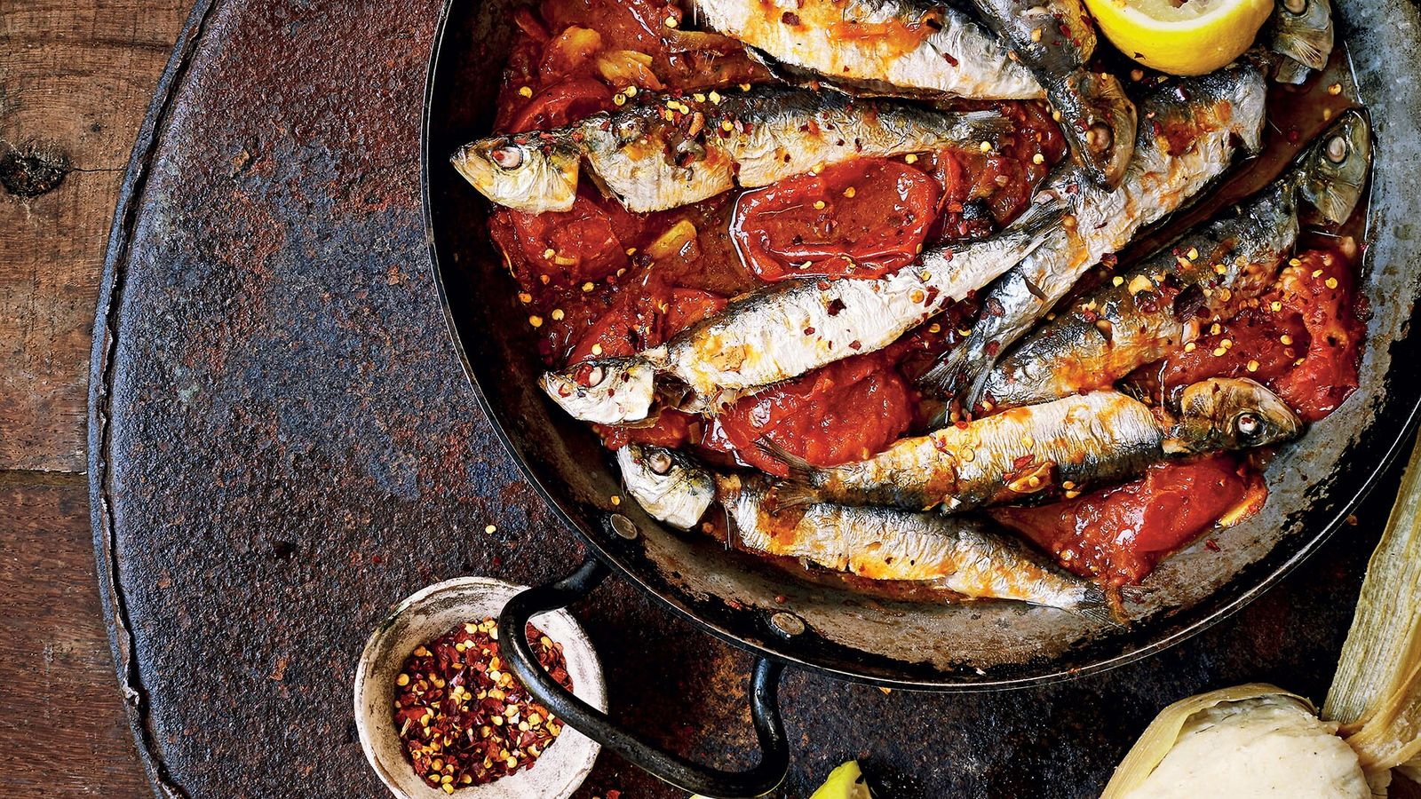 Grilled sardines with kenkey (fermented corn dumplings) is one of Zoe's most delicious Ghanian recipes.