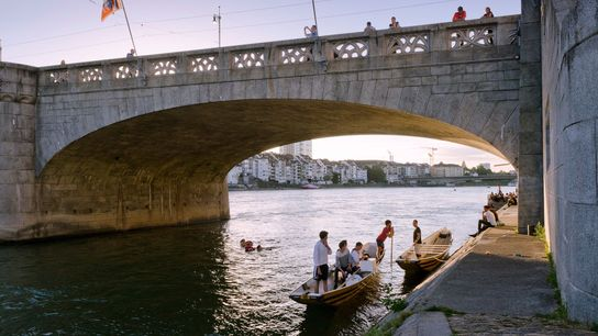 Boaters catch up in the shadow of Middle Bridge, in the heart of Basel.