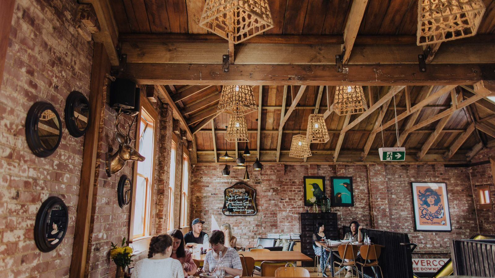 Interior of Vogel St Kitchen, an industrial dining space serving wood-fired pizzas.
