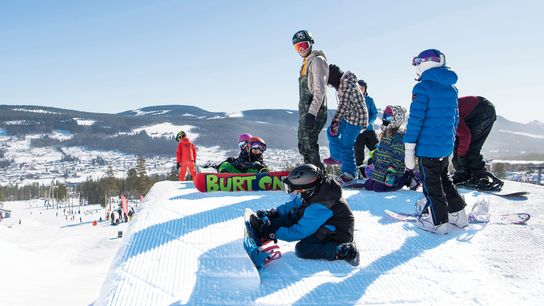 Snow park in Trysil, Norway where a group is getting read to snowboard down the mountain