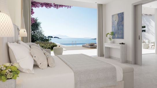 Floor-to-ceiling windows and breezy seaside decor are standard at Ikos Aria, with many of the rooms ...