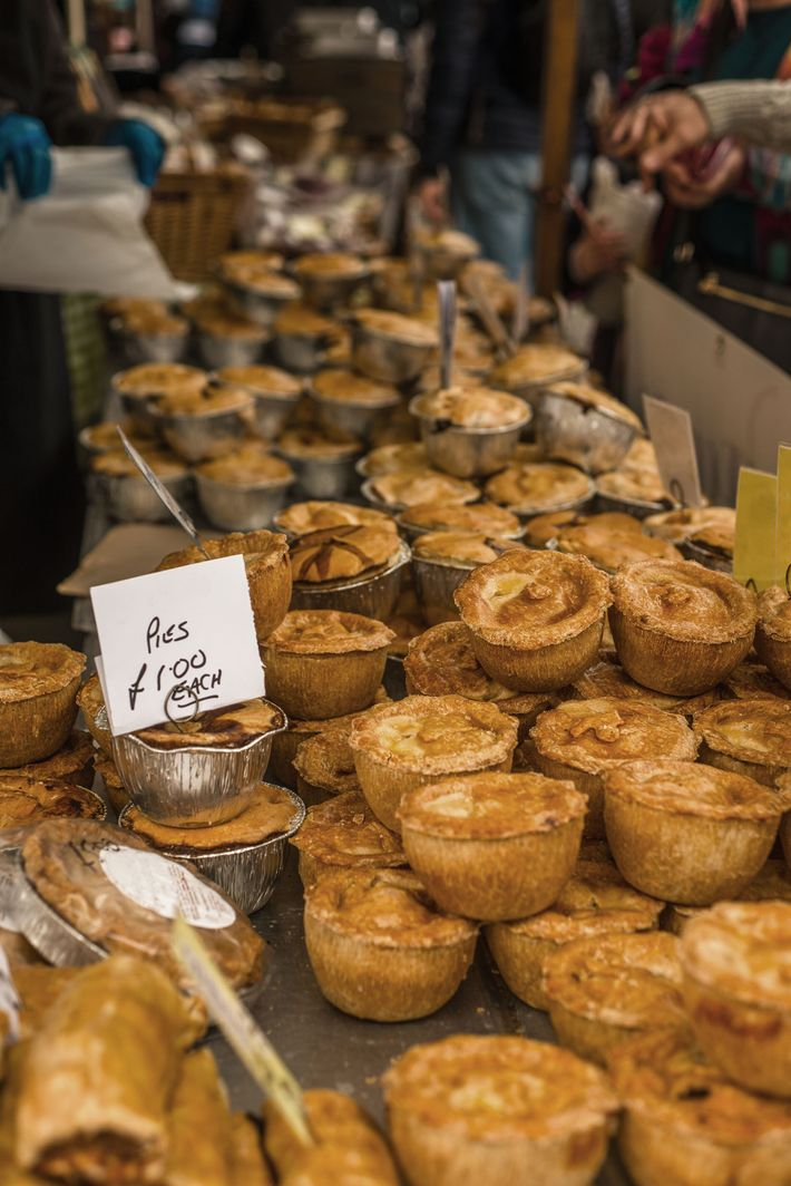 Savoury pies for sale at a market stall in Frome.
