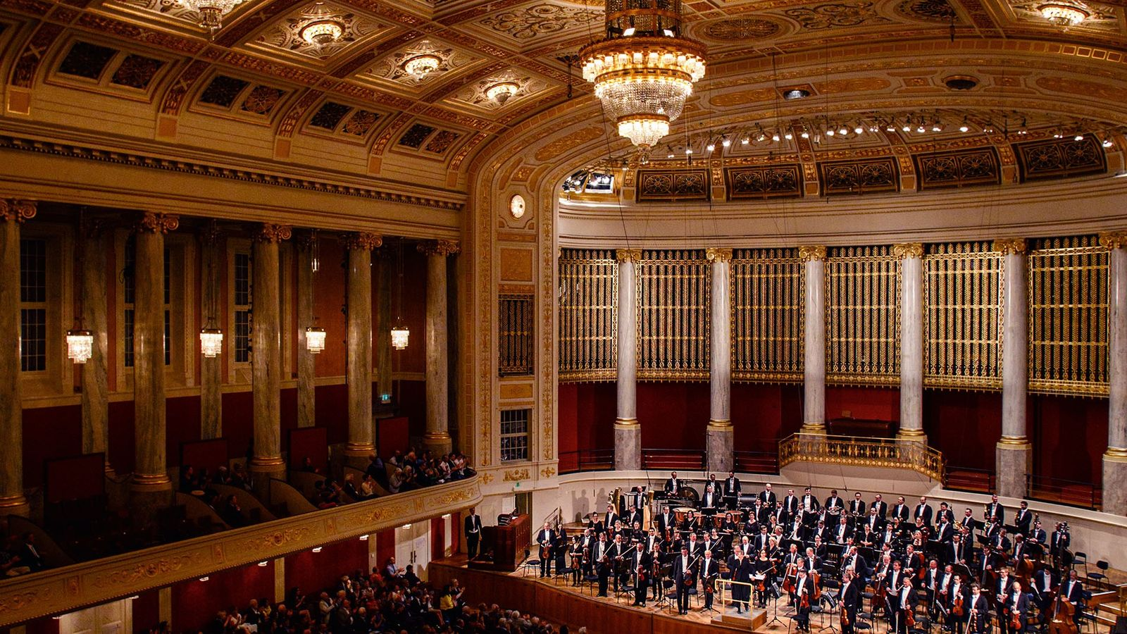 Orchestra on stage at the Vienna Opera House.