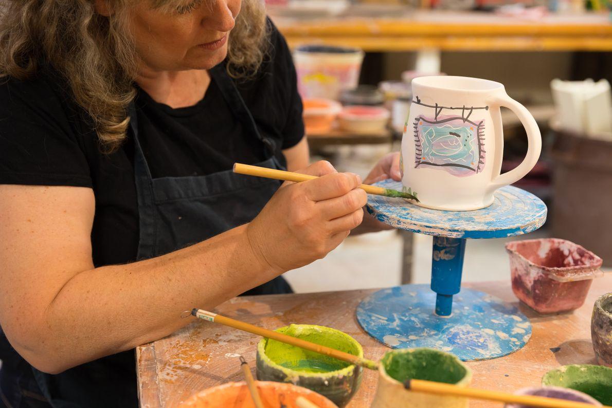 Staci Barron, Elora Pottery, working in her studio.