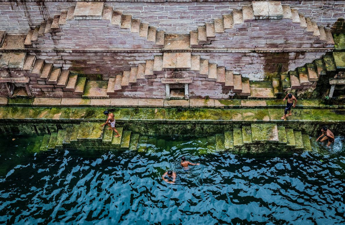 A bunch of Village boys cooling it off in an ancient Toorji Step well built by ...