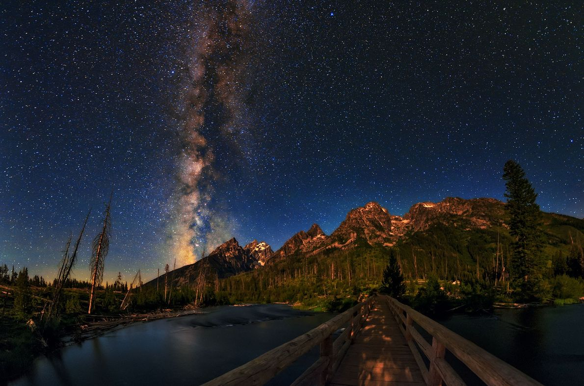 The night sky over the Grand Teton National Park in Wyoming, USA. The bright summer Milky ...