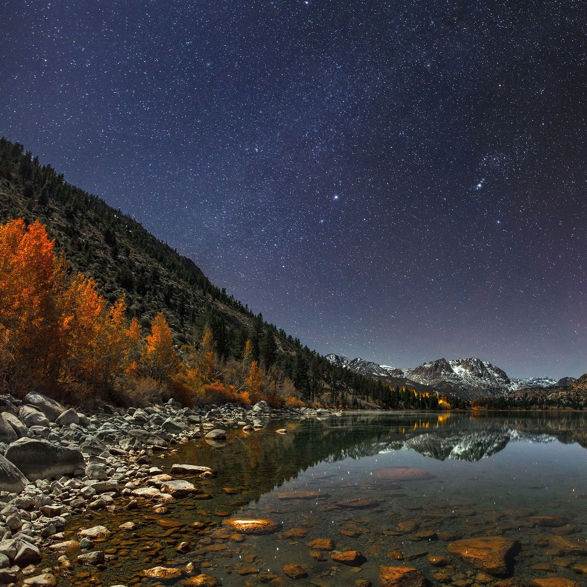 The night sky reflects off of June Lake in the Sierras.
